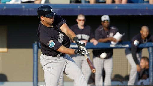 New York Yankees' Gary Sanchez bats against the Washington Nationals in a spring training baseball game, Wednesday, March 23, 2016, in Viera, Fla.