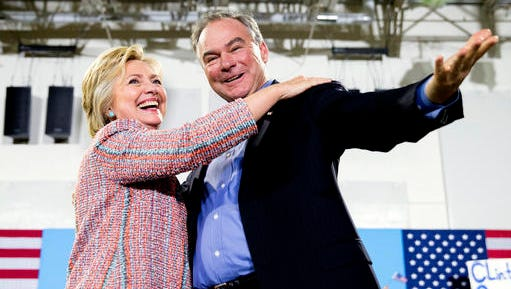 In this July 14, 2016, file photo, Democratic presidential candidate Hillary Clinton, accompanied by Sen. Tim Kaine, D-Va., speaks at a rally at Northern Virginia Community College in Annandale, Va. Clinton has chosen Kaine to be her running mate.