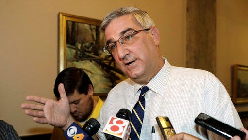 FILE - In this July 15, 2016, file photo, Indiana Lt. Gov. Eric Holcomb responds to reporters' questions in Indianapolis. Gubernatorial candidates in some states including Indiana have been staking strategic positions contrary to their party's national norms and presidential nominees. Lt. Gov. Holcomb faces Democratic candidate John Gregg in the general election. (AP Photo/Darron Cummings, File)