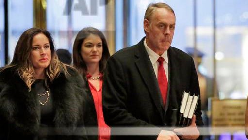 Rep. Ryan Zinke, right, Donald Trump's nominee for interior secretary, arrives at Trump Tower in New York for a meeting with the president-elect.