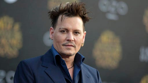 "FILE - In this May 23, 2016 file photo, Johnny Depp arrives at the premiere of ""Alice Through the Looking Glass"" at the El Capitan Theatre, in Los Angeles. Johnny Depp is suing his former business managers alleging they mismanaged his earnings throughout his career, although the company says the actor's spending is to blame. Depp's lawsuit filed Friday, Jan. 13, 2017 in Los Angeles Superior Court against The Management Group seeks more than $25 million, alleging its owners failed to properly pay his taxes, made unauthorized loans and overpaid for security and other services, but the company's attorney says the managers tried for years to control Depp's spending. (Photo by Richard Shotwell/Invision/AP, File)"