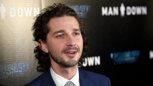 "FILE - In this Nov. 30, 2016 file photo, Shia LaBeouf arrives at the Los Angeles premiere of ""Man Down"" at ArcLight Cinemas Hollywood. LaBeouf has been arrested early Thursday morning, Jan. 26, 2017, after he allegedly got into an altercation with another man outside a New York City museum. Police say LaBeouf pulled the scarf of an unidentified 25-year-old man early Thursday morning outside the Museum of the Moving Image in Queens, scratching his face in the process."