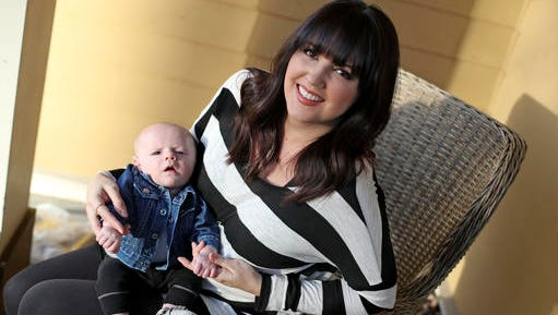 """Rachel Potter holds her son, Jude, Tuesday, Jan. 31, 2017, at their home in Nashville, Tenn. Potter, a Nashville-based singer who has toured the country as part of the cast of the hit musical """"Wicked"""" as well as performing gigs with her country music band Steel Union, said she couldn't afford insurance before the Affordable Care Act. From a return to higher premiums based on female gender, to gaps in coverage for breast pumps used by nursing mothers, President Donald Trump's vow to repeal his predecessor's health care law is raising concerns about the impact on women's health."""