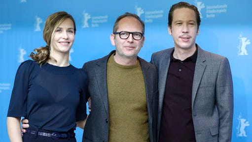 From left, actress Cecile de France, director Etienne Comar and actor Reda Kateb pose for the photographers during a photo call for the film 'Django' at the 2017 Berlinale Film Festival in Berlin, Germany, Thursday, Feb. 9, 2017.