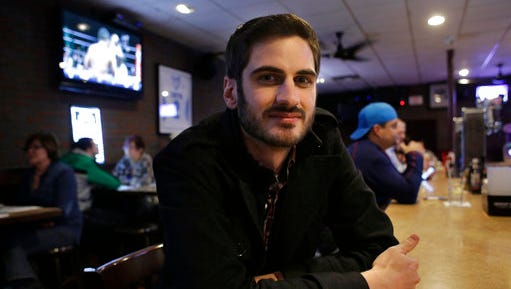 In this Wednesday, Feb. 22, 2017 photo, Matt Garlock, of Mansfield, Mass., poses for a photo in a bar in Somerville, Mass. The 29-year old has trouble making out what his friends say in loud bars, but when he got a hearing test, the result was normal. Scientists have been finding evidence that loud noise, from rock concerts, leaf blowers, power tools and the like, damages our hearing in a previously unsuspected way. It may not be immediately noticeable, and it does not show up in standard hearing tests.