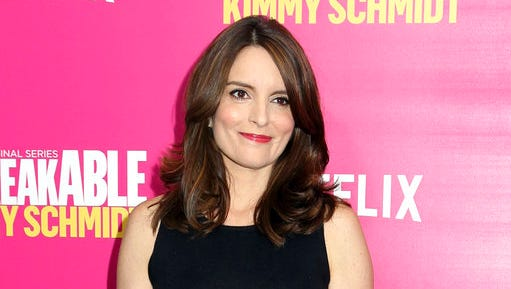 "FILE - In this March 30, 2016 file photo, Tina Fey attends the premiere of Netflix's ""Unbreakable Kimmy Schmidt"" Season 2 in New York. Fey's stage adaptation of ""Mean Girls"" will make its world premiere at The National Theatre in Washington, D.C. The new musical, based on the 2004 film about a naive girl who falls in with her new high school's coolest, prettiest, most treacherous triumvirate of girls, called The Plastics, will run from Oct. 31-Dec. 3."