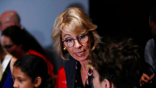 Education Secretary Betsy DeVos talks to students at the Smithsonian's National Air and Space Museum in Washington, Tuesday, March 28, 2017, during an event to celebrate Women's History Month.