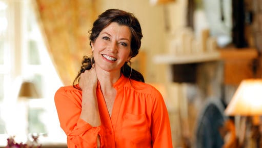 FILE - In this April 25, 2016 file photo, singer Amy Grant poses for a portrait at her home in Nashville. Grant and Nashville philanthropist Martha R. Ingram will be honored with stars on the Music City Walk of Fame next month in Tennessee. The Nashville Convention & Visitors Corp. made the announcement Thursday, March 30, 2017.