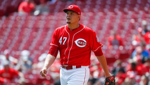 Cincinnati Reds starting pitcher Sal Romano reacts after striking out his first batter during his major league debut in the first inning of a baseball game against the Milwaukee Brewers, Sunday, April 16, 2017, in Cincinnati. The Brewers won 4-2. (AP Photo/John Minchillo)