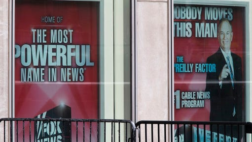 Posters featuring Bill O'Reilly are displayed at the News Corp. headquarters in Midtown Manhattan, Wednesday, April 19, 2017. O'Reilly has lost his job at Fox News Channel after allegations that he sexually harassed women.