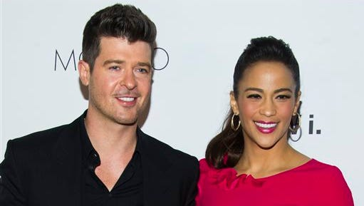 """Robin Thicke and Paula Patton attend the sixth annual GQ Gentlemen's Ball in New York. Patton has filed for divorce from Thicke and is asking for joint custody of their son. Patton filed in Los Angeles on Oct. 3 citing """"irreconcilable differences."""""""