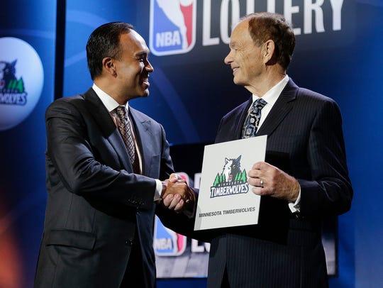 NBA Deputy Commissioner Mark Tatum, left, congratulates