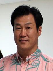 John S. Ko, President of NET Enterprises INC