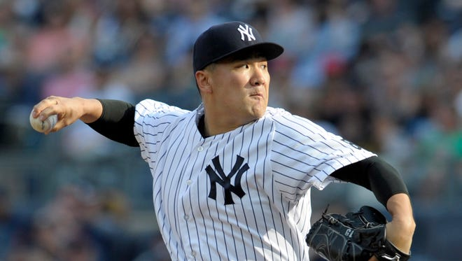 New York Yankees pitcher Masahiro Tanaka delivers to the Tampa Bay Rays during the first inning of a baseball game Saturday, Sept. 10, 2016, at Yankee Stadium in New York.