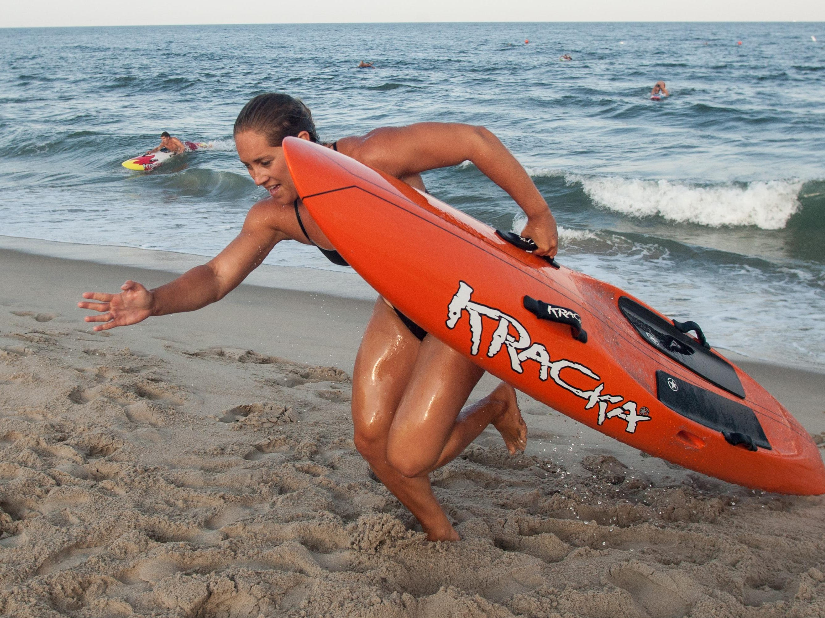 Belmar's Amelia Buckley anchors the paddle relay during the 47th Annual Ocean Grove Lifeguard Tournament on Monday.