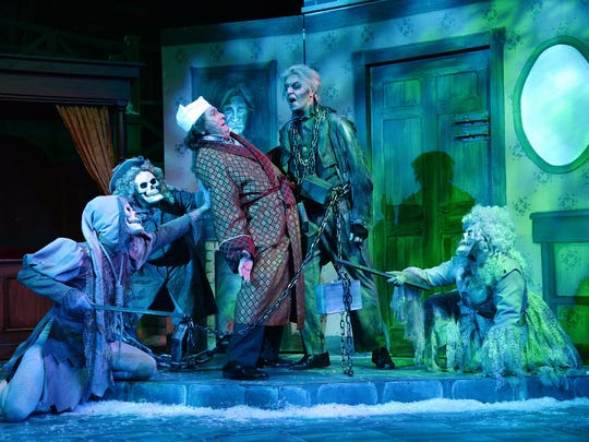 """Scrooge is visited by The Ghost of Jacob Marley in New Stage Theatre's """"A Christmas Carol."""""""