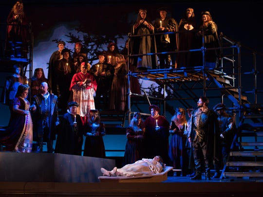 The moving funeral of Ophelia features a cast holding lit candles and a burial on stage in OperaDelaware's 2016 Opera Festival's 'Amleto' (Hamlet).