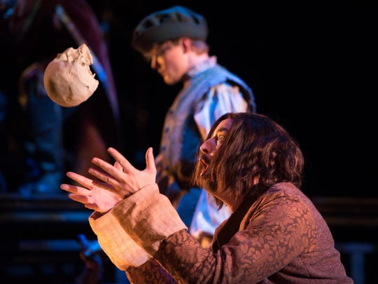 The First Gravedigger (Harold Wilson) tosses poor Yorick's head around in great jest during OperaDelaware's 2016 Opera Festival's 'Amleto' (Hamlet).