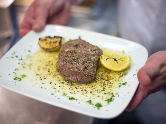A petite Greek tenderloin broiled with lemon, garlic, butter and oregano at Number 5 restaurant in Binghamton.