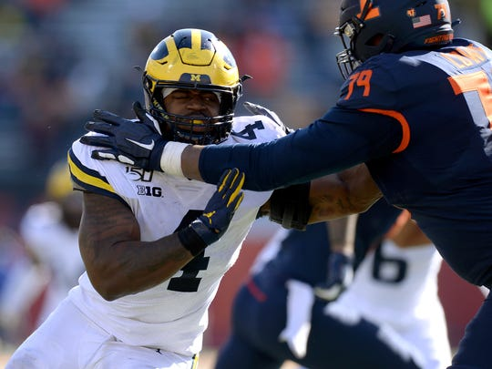 Oct 12, 2019; Champaign, IL, USA; Michigan Wolverines defensive lineman Michael Danna (4) works against Illinois Fighting Illini offensive lineman Vederian Lowe (79) during the second half of the game at Memorial Stadium. Mandatory Credit: Michael Allio-USA TODAY Sports