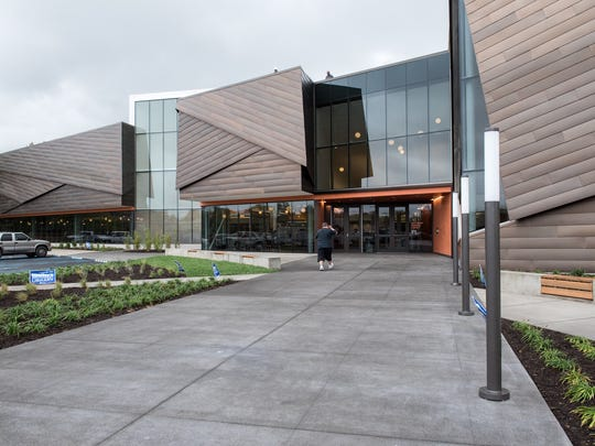 A visitor walks to the entrance of the Louisville Free Public Library's Southwest Regional Library at 9725 Dixie Highway near Valley High School. The new branch opened Oct. 5.