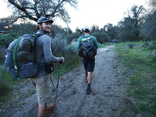 Winter time PCT through hikers Justin Lichter, right, and Shawn Forry make their way to the Lake Morena County Park campground on their second to last day of their historic journey to the Mexican border on Feb. 28, 2015.