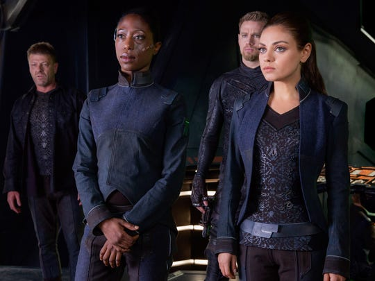 "Sean Bean as Stinger Apini (from left), Nikki Amuka-Bird as Diomika Tsing, Channing Tatum as Caine Wise and Mila Kunis as Jupiter Jones appear in a scene in ""Jupiter Ascending,"" an original science fiction epic adventure from Lana and Andy Wachowski."