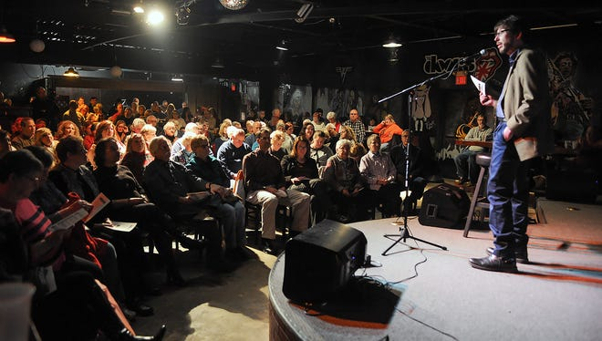 Crowds listen as Battle Creek Enquirer Executive Editor Michael McCullough speaks to the audience about the Mosaic Storytelling Showcase Tuesday night.