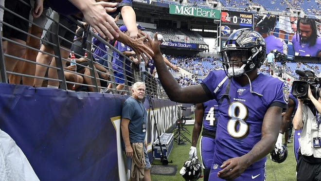Baltimore Ravens quarterback Lamar Jackson acknowledges fans prior to a Sept. 29, 2019, game against the Cleveland Browns in Baltimore.