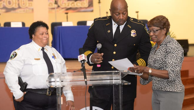 Shreveport Mayor Ollie Tyler, Police Chief Willie Shaw and Capt. Jacqueline Willis gather at the podium during the Enough is Enough Stop the Violence Rally.