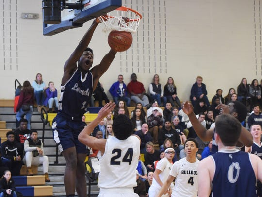 Lourdes' Kevin Townes lands a dunk during a Jan. 14 game against Beacon.