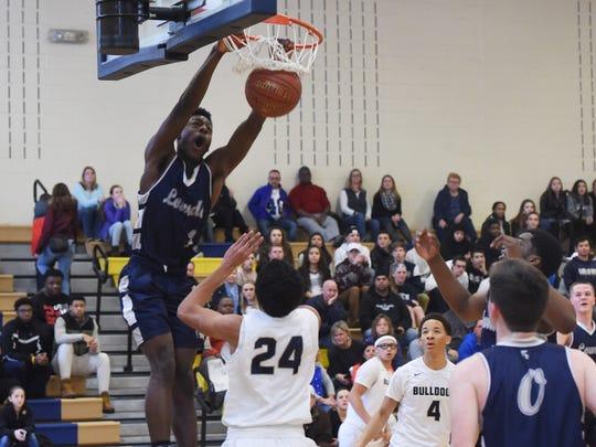 Lourdes' Kevin Townes lands a dunk during a Jan. 14