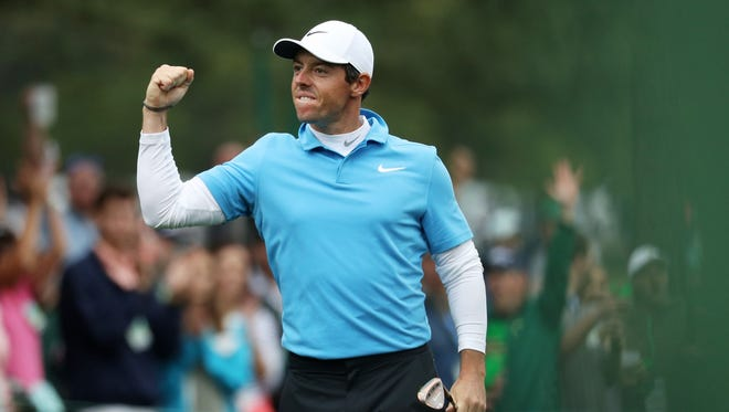 Rory McIlroy celebrates making eagle on the eighth hole during the third round of the 2018 Masters Tournament at Augusta National Golf Club on April 7.