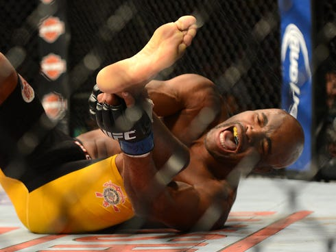 Dec 28, 2013; Las Vegas, NV, USA;    Anderson Silva reacts after breaking his leg on a kick to Chris Weidman (not pictured) during their UFC middleweight championship bout at the MGM Grand Garden Arena. Mandatory Credit: Jayne Kamin-Oncea-USA TODAY S