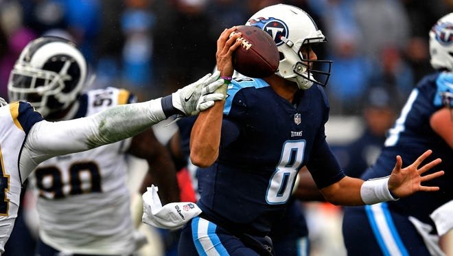 Rams linebacker Robert Quinn (94) gets a hand on Titans quarterback Marcus Mariota (8) arm as he prepares to pass in the fourth quarter at Nissan Stadium Sunday, Dec. 24, 2017 in Nashville, Tenn. The Rams beat the Titans 27-23.
