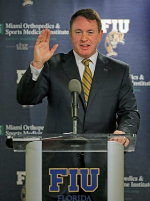 Butch Davis speaks at a news conference after he was introduced as the new head coach of FIU during an NCAA college football news conference Tuesday at FIU Stadium in Miami.