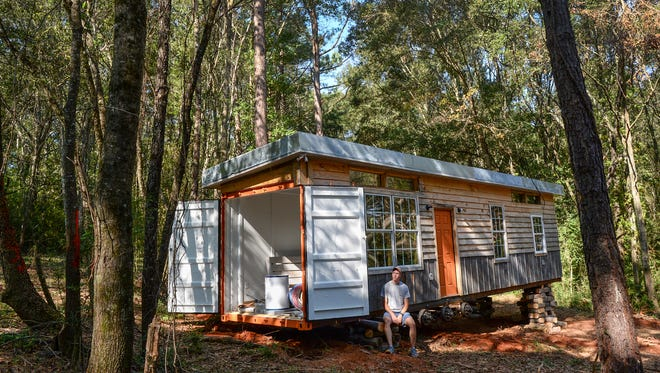 Tyler Wrenn, a sophomore at Clemson University, sits at his nearly completed tiny house in Pendleton. Wrenn watched a TV show featuring tiny houses in high school, and figured he would save nearly $5,000 over his years at Clemson by making the tiny house instead of renting.