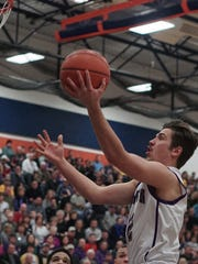 Lexington's Joey Vore goes for a lay-up during their