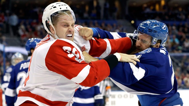 Lightning defenseman Luke Witkowski and Red Wings right wing Anthony Mantha fight during the first period of the Wings' 5-3 loss on March 30, 2017 in Tampa, Fla.