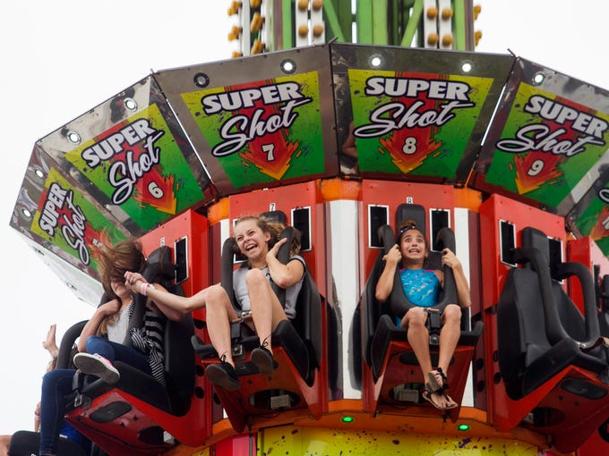 Jackie Rudas, 9, right, and Taylor Rasmussen, 12, ride
