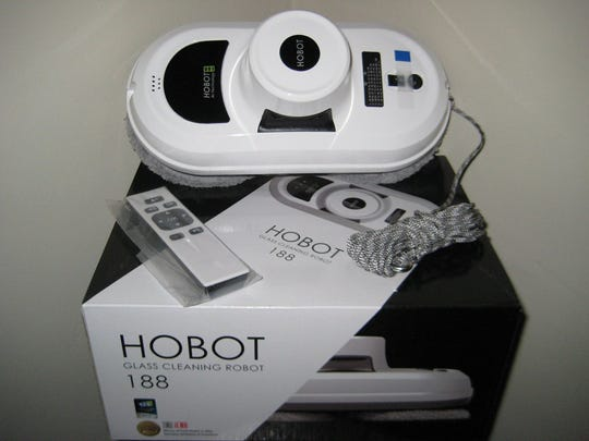 The remote-controlled HOBOT-168 Window Glass-Cleaning Robot adheres to and cleans any type of window.