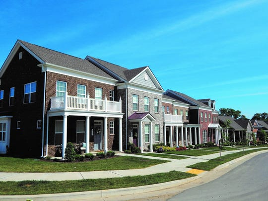 A rendering shows townhomes planned at Burkitt Ridge.