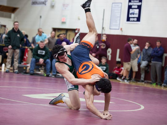 Aaron Wolk of Horace Greeley faces off against Grant Cuomo of Brewster for the 160lb class Section 1 Division 1 Championship title at Arlington High School in Arlington, February 11, 2017