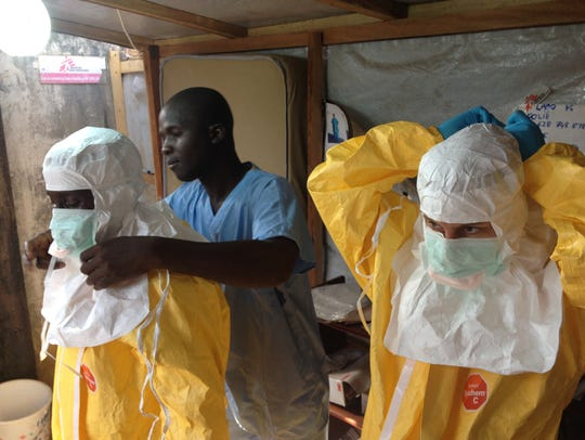 Workers fighting the Ebola outbreak in Africa don Tyvek