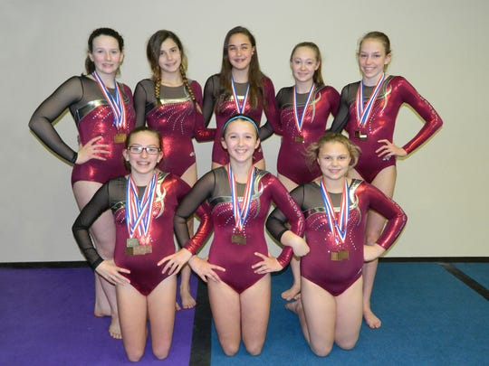 Russell Gymnastics Xcel gymnasts, pictured left to right: (front row) Mason Schuld, Haley Karr, Abigail Hartleb; (back row) Morgan Fillmore, Avianna Lansing, Olivia Heese, Makenna Fisher, McKenzie Schuld. Missing from photo: Kanosha Xiong.