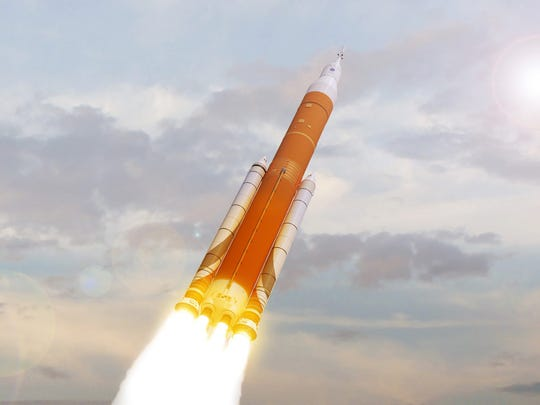 A rendering of NASA's Space Launch System rocket and Orion crew capsule blasting off from Kennedy Space Center.
