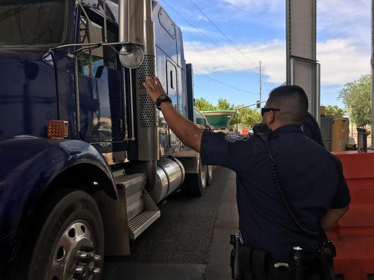 A Customs and Border Protection officer waves down