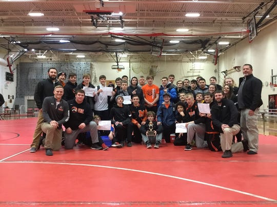The Marshfield wrestling team took first at the Shawano Holiday Classic on Saturday. The Tigers had four first place finishers.