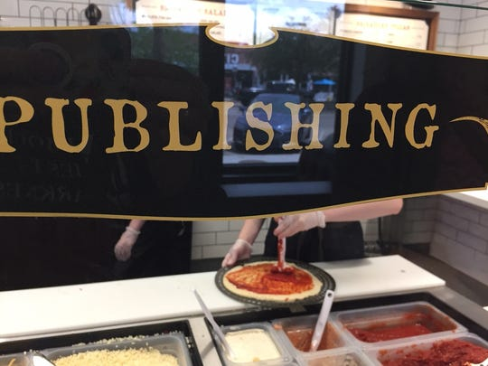 The Pizza Press features a newspaper theme, with aptly