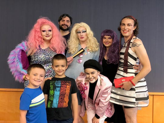 Rob Salamo (back center) enjoys a photo after Drag Storytime with (clockwise from left) Hazy Buchanan (Ellie Rupp), Spjork (Layne Oliver), Molly Pop (Emily Brehm-Stecher), Anya Marx (Ryan Hall), Lil Ronnie (Sydney Speltz), and Salamo's sons. Drag Storytime was held at the Iowa City Public Library.